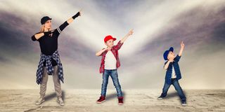 Mother and two son dance hip-hop.Urban lifestyle. Hip-hop generation. Urban lifestyle. Hip-hop generation.Mother and two son dance hip-hop Royalty Free Stock Photo