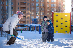 Mother and two son enjoying beautiful winter day outdoors Royalty Free Stock Images