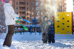 Mother and two son enjoying beautiful winter day outdoors Stock Photos