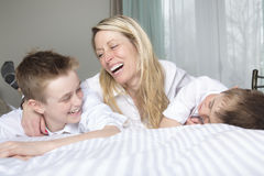 Mother And two Son Relaxing Together In Bed Royalty Free Stock Image