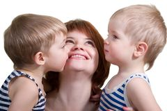 Mother with two sons. Happy young mother with two cute little sons. Isolated on white background Royalty Free Stock Photography