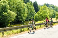 Mother with two sons on bicycle trip Royalty Free Stock Image