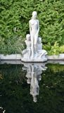 Mother and Two Sons. This is a Fall picture of a sculpture on a reflecting pool displayed at the Boerner Botanical Gardens, located in Milwaukee Wisconsin Stock Photography