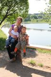 Mother and two sons by lake Royalty Free Stock Images