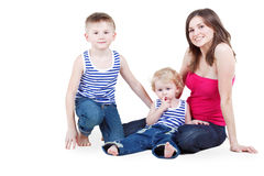 Mother and two sons sit on floor Stock Photo