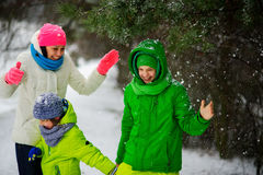 Mother with two sons on walk in winter day. Royalty Free Stock Image