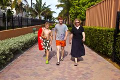 Mother with two sons on the way to the beach Royalty Free Stock Images
