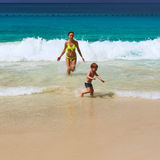 Mother and two year old boy playing on beach Royalty Free Stock Image