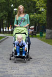 Mother with two year old son in summer park. Young mother with two year old son in summer park Royalty Free Stock Photo