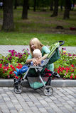 Mother with two year old son in summer park Royalty Free Stock Images