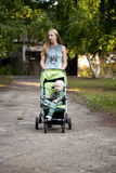 Mother with two year old son in summer park Stock Photography