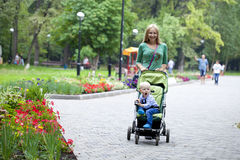 Mother with two year old son in summer park Royalty Free Stock Photos