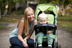 Mother with two year old son in summer park Stock Photos