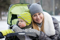 Mother with two year old son in winter park. Young mother with two year old son in winter park Stock Image