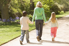Mother and two young children walking on path Stock Photography