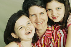 Mother and Two Young Daughters Stock Photos