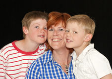 Mother and two young sons. Posing together Royalty Free Stock Photos
