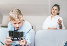 Mother unhappy with teenager son who spent his free time with el stock image