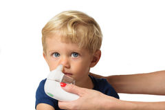 Mother cleaning kid boy nose Royalty Free Stock Image