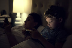 Mother with using modern devices before sleep Stock Photography
