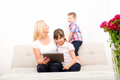 Mother using a Tablet PC Stock Photos