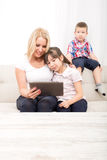 Mother using a Tablet PC Royalty Free Stock Photos