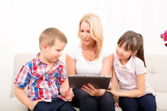 Mother using a Tablet PC Royalty Free Stock Image