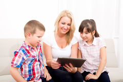 Mother using a Tablet PC Stock Image