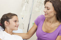 Mother Visiting Daughter Patient In Hospital Bed Royalty Free Stock Photo