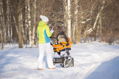 Mother walk with baby in carriage in park Stock Photography