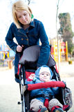 Mother walking baby Royalty Free Stock Photos