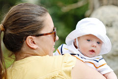 Mother walking with baby boy Stock Image
