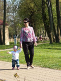 Mother walking baby daughter Stock Photos