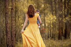 Mother Walking with Baby Son in Forest Royalty Free Stock Photo
