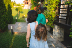 Mother Walking with Daughter over Shoulder Royalty Free Stock Image