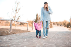 Mother walking with daughter in park Stock Image