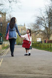 Mother Walking Daughter To School Along Path Stock Images