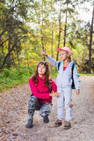 Mother walking with her child in warm sunny autumn day stock image