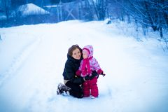 Mother walking with her little daughter in winter Stock Images