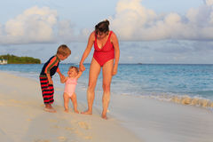 Mother walking with kids on beach vacation Stock Photography