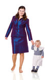 Mother walking with little son Stock Images