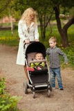Mother is walking Royalty Free Stock Photo