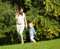 Mother walking outdoors with baby. Portrait of a mother walking outdoors with baby stock photos
