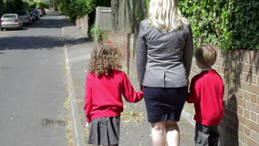 Mother Walking To School With Children On Way To Work Royalty Free Stock Photography