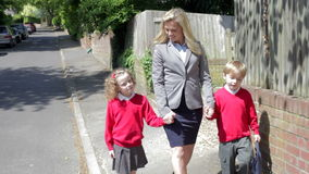 Mother Walking To School With Children On Way To Work stock footage