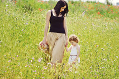 Mother walking with toddler girl Stock Photos