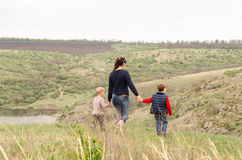 Mother walking with two boys in the countryside Royalty Free Stock Image