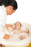 Mother washing her newborn baby Royalty Free Stock Image