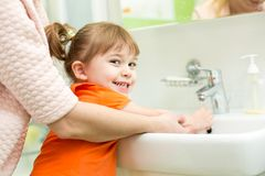 Mother washing kid hands Royalty Free Stock Images