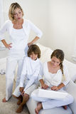 Mother watching children use laptop royalty free stock photo